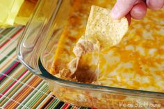 Texas Trash recipe: 1 package cream cheese 1 cup sour cream 2 cans (16 ounces, each) refried beans 1 packet taco seasoning 2 cups cheddar cheese, shredded 2 cups monterey jack cheese, shredded