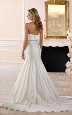 From Stella York, this curve hugging wedding gown is the fit-and-flare of your dreams! Grand Mikado fabric in a drop-waist, fit-and-flare silhouette.
