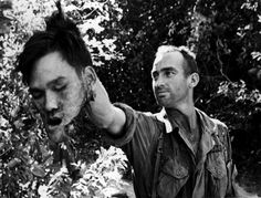"""A U.S. paratrooper of the """"hatchet team"""" of B Company, 502nd Battalion, 101st Airborne Division, holds the severed head of a Viet Cong guerrilla who was killed in hand-to-hand jungle fighting 12 miles northwest of Ben Cat during the Vietnam War, Dec. 12, 1965. The company had chased a squad of Viet Cong guerrillas, one of whom dropped a grenade that wounded several soldiers. Soldiers jumped the the guerrilla and beheaded him by hatchet. His head was buried in the jungle. Brutality"""