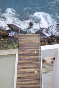architecturally amazing, this glass encased 'boardwalk like' look-out deck overhangs a rocky cliff with an up-close and personal view of the sea.