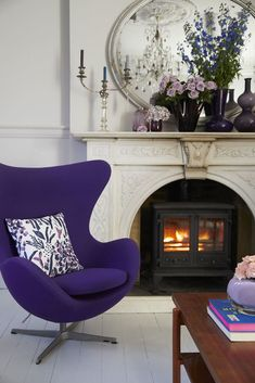 Pantone's Ultra Violet is a bold, vivid shade, that on the one sense evokes a sense of creativity and fantasy, and on the other, a sense of balance and harmony. This purple armchair complements the patterned cushion and gorgeous flowers on the fireplace mantel. (Photo: Hillarys)