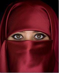 Beautiful eyes peek from traditional Muslim headwear