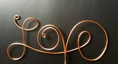 Available in copper or silver wire. It is 6 1/4 long, the letters range from 3 1/4 tall to 2 1/4 tall, and it has a 3 stem. It can be made larger or smaller at no additional cost.