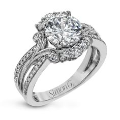 Turn heads with this stunning white gold ring that glitters with an impressive .58 ctw of round white diamond accents.