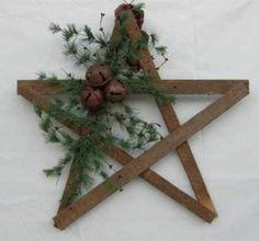 DIY rustic Christmas star | paint stir sticks, twine, greens, bells