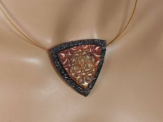 Polymer clay pendant, shield, black, gold, copper by RadiantOriginals on Etsy
