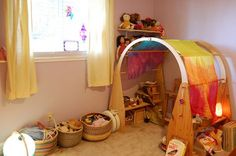 Waldorf playspace.  (Am currently saving up for those playstands and the big playsilk.)