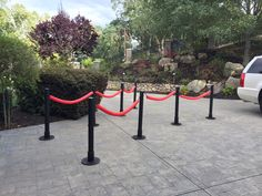 Stanchions made with mailing tubes, $ store pool noodles, $ store rope & $ store red table cloths. Bases made out of cardboard rounds gorilla glued together with cardboard cuff for mailing tubes to fit into.