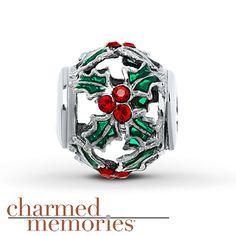 A cutout holly design adorns this lovely sterling silver bead from Charmed Memories®. Green accents and red SWAROVSKI ELEMENTS complete the look.