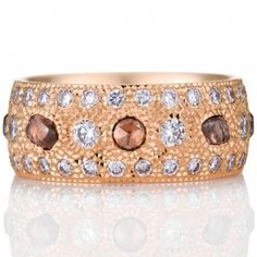 Talisman Diamond Band with a total of 70 diamonds, set in pink gold.  DeBeers