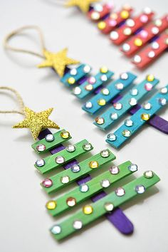 DIY Popsicle Stick Christmas Tree Ornaments - DIY Christmas Ornaments For Kids gifts diy for kids 13 DIY Holiday Ornaments Kids Can Make - Pretty My Party - Party Ideas Popsicle Stick Christmas Crafts, Stick Christmas Tree, Dollar Store Christmas, Easy Christmas Crafts, Noel Christmas, Craft Stick Crafts, Fun Crafts, Christmas Feeling, Popsicle Sticks
