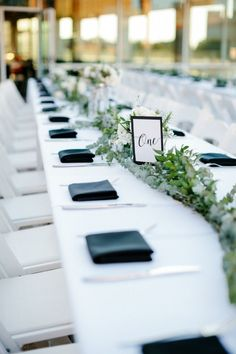 Modern + elegant black and white tablescape: http://www.stylemepretty.com/wisconsin-weddings/madison-wi/2015/11/23/modern-art-gallery-wedding-3/   Photography: Carly McRay - http://www.carlymccrayphotography.com/