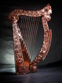 """Based on the ancient folklore, the Irish harp is one of the world's oldest instruments. The ancient Irish kings employed harpist to entertain them. At one sad point in Irish history conquering invaders made it illegal to posses an Irish harp and set out to burn every harp in Ireland in an attempt to kill the """"Irish spirit"""". Greatly honored, the harp is the national emblem of Ireland."""