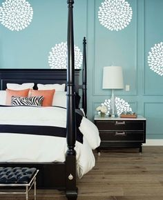Chrysanthemum Wall Paper; lovely light teal and orange. Elegant but eclectic bedroom.