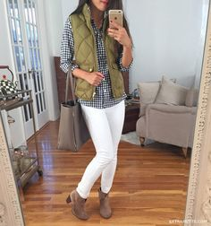 Fall casual outfit idea: j.crew puffer vest, gingham shirt, white skinny jeans, ankle boots