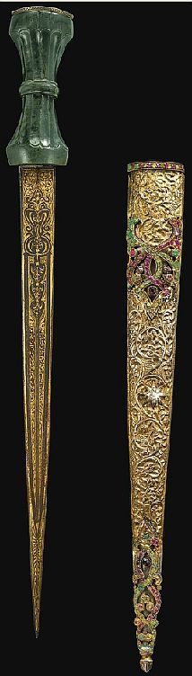 Ottoman hancer / court dagger, 19th century, straight steel blade with central ridge, wholly decorated with gold gilt inscriptions and varied motifs, the waisted dark-green jade hilt with carved flutes, the pommel embellished with openwork silver set with gemstones, the engraved silver scabbard adorned with cabochon and faceted gemstones to one side of the scabbard.