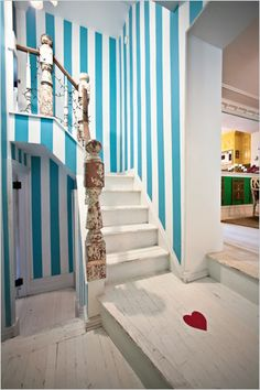 I love the blue stripes and white wash wood.