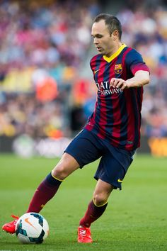 Andres Iniesta of FC Barcelona runs with the ball during the La Liga match between FC Barcelona and CA Osasuna at Camp Nou on March 16, 2014 in Barcelona, Catalonia.