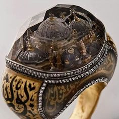 Sevan Biçakçi ring showing a range of techniques including intaglio carving and calligraphy.