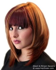 Long bob with tapered sides and full bangs. Hair coloring with color blocking.