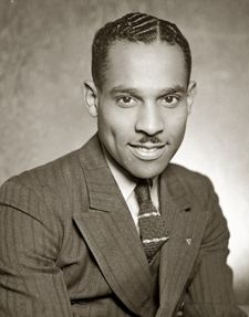 """Charles """"Teenie"""" Harris - Grew up in Hill District & developed strong interest in photography. In 1929, accepted freelance position for Wash., D.C.-based Flash! magazine. In 1938, opened own photography studio on Centre Ave. In 1936, began freelancing for Pittsburgh Courier, becoming full-time in 1941. Took more than 80,000 photos, capturing Pittsburgh, as well as many celebrities & dignitaries, including Pres. John F. Kennedy, Joe Louis, Roberto Clemente, Duke Ellington & Lena Horne."""