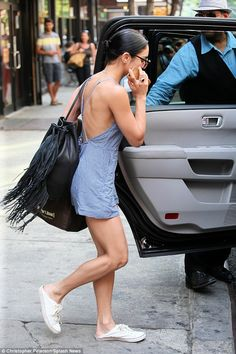 Back to work: The 26-year-old was headed to her show as she wore white sneakers that she h...