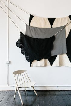 Throw blankets display; Minimalist props; Timber floorboards; Neutral walls.