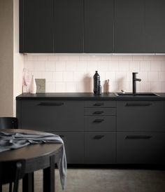 IKEA just keeps upping their sustainability game. bottles are used to create each of these IKEA kitchen units, designed by Swedish studio Form Us With Love. Black Kitchen Cabinets, Kitchen Units, Black Kitchens, New Kitchen, Cool Kitchens, Minimal Kitchen, Ikea Kitchens, Black Ikea Kitchen, Modern Cabinets