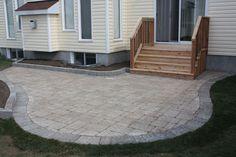 stone patios, deck leading to flagstone patio - Organicoyenforma