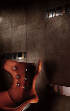 Striking, deep #metallic tiles and #inlays add depth and extravagance to these rich brown #porcelain tiles. #UnionTiles