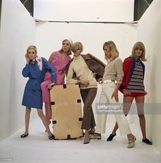 English fashion model Twiggy (left) poses with four other models and a  wooden crate 93d2ce860f