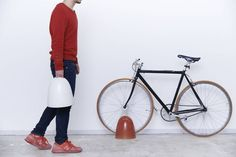 The heft of Cachicochi's Trip stand will ensure your bike will stay upright, while its simple dome shape not only camouflages the fact that it's a bike stand, but is unobtrusive in the home.