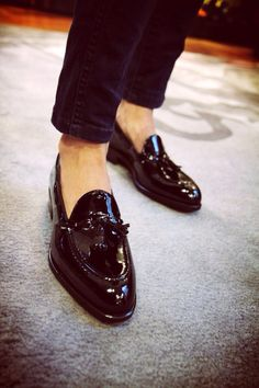 Shining shimmering black shoe with tassel
