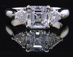 Diamond Rings : An Asscher-cut diamond set with two calf-head diamonds in a hand-crafted platinu