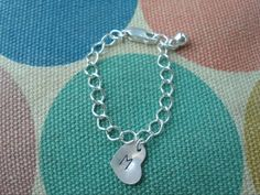 Infant Sterling Charm Bracelet I need a girl! Find Treasured Trinkets on Facebook.