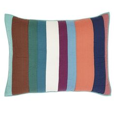 This sham features various sized strips of seersucker fabrics in coral, off-white, brown, mauve, fuchsia, and shades of blues and greens.  https://www.uptowncasual.com/products/kailani-quilted-standard-sham-21x27 #uptownquiltedbedding