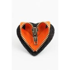 Brooch made out of recycled zippers by Globe Hope