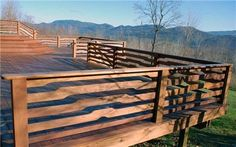 wood deck railing - so very awesome....look at the way the design matches the horizon!