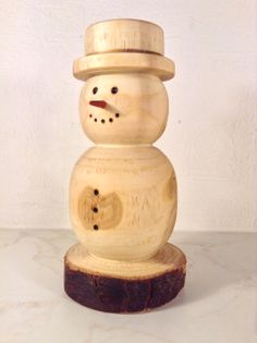 Snowman. Wood: Firewood & Padauk (nose). @ Ansbach Artisans