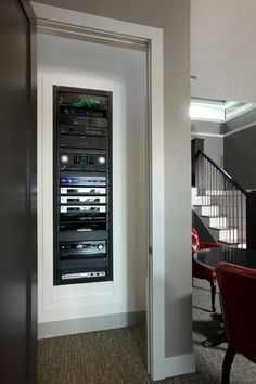 Neat and tidy equipment closet | Cleanly Executed | CEDIA Media Room Installers