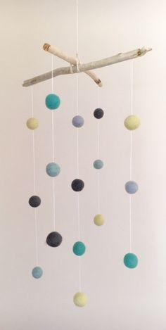 This gorgeous coloured mobile comprises of 16 wool felt balls hanging from beautiful driftwood gathered from our stunning South Coast beaches