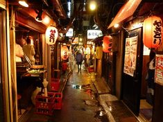 An alley lined with cheap street food and izikaya, Tokyo, Japan