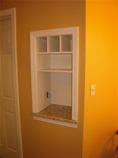 Between the studs – Built in nook for purses, cell phones, mail! And an outlet on the inside – this is genius.