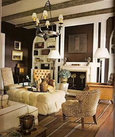 Great contrast between chocolate walls and bright white molding (Dark Walls Inspire!)