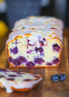 This Lemon Blueberry Explosion Loaf is actually a home-made Copycat Starbuck's Lemon Loaf except this lemony loaf has an explosion of robust blueberries inside that will absolutely tantalize your taste buds! It's superbly finished off with a simple old-fashioned powdered sugar glaze! #lemon #starbucks #loaf #bread #breakfast #snack #blueberries
