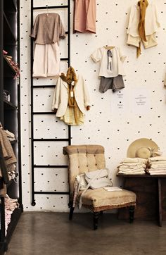 This is a boutique in Paris but is a charming look for a kids room. Polka dots and sweet outfits on display.