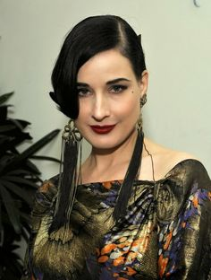 Dita von Teese with Chanel earrings