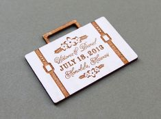 Suitcase wedding invitation  The invitation was made from wood with engraved and laser cut. Its such a really great idea for more unique invitation. by weddingcard