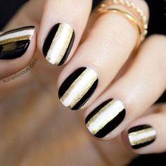 black, white, and gold nail art