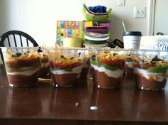 Individual 7 layer dipping cups. Party food apps :)